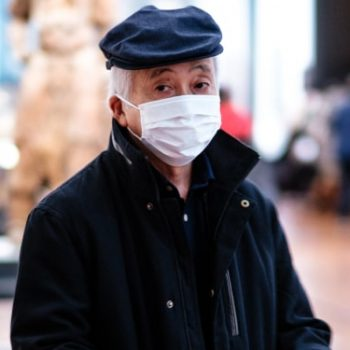 China Sneezes and the World Catches Pneumonia, man wearing face mask
